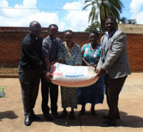 MALAWI: Catholic Secretariat Staff donate food to street children