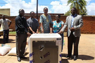 From Left. Fr Phokoso,Fr. Kamera,Sister Massawe,Tikondane Staff Member and Director of Finance and Administration for Catholic Secretariat,Mr. Aggrey Mwale