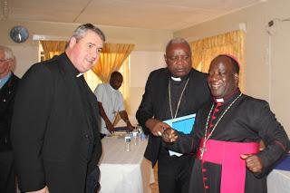 Fr. Andrew Small interracting with Archbishop  Thomas Msusa  and Bishop Martin Mtumbuka