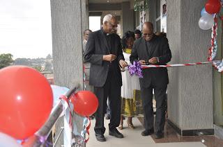 Apostolic Vicar of Soddo Rt. Rev. Tsgaye Keneni, and ECS Secretary General Fr. Hagos cuts the ribbons at the inauguration of Micro Finance Institute in Soddo