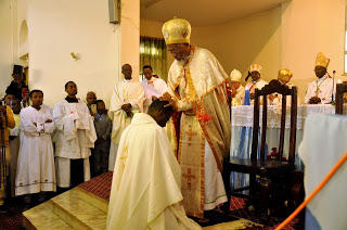 Abune Seyoum recieivng his miter from H.E. Cardinal Berhaneyesus