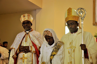 Bishop Seyoum (left) with his mother and his Bishop Rt. Rev. Abraham Desta of Meki