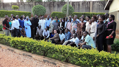 Education scholars from East Africa region pose for a group photo  with Bishop Martin Wamika of Jinja Diocese
