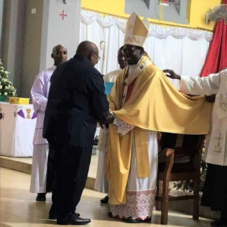 H. E. Polycarp Cardinal Pengo, Archbishop of Dar es Salaam, Tanzania being congralutated by His Excellency Benjamini Mkapa, the former President of Tanzania.