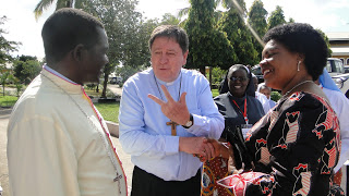 Right: Hon Jenista Mhagama, Minister of States in the  Office of Prime Minister in Tanzania sharing a word with H.E.  João Cardinal Bráz de Aviz, Prefect of the  Congregation for Institute of Consecrated Life and  Societies of  Apostolic Life and  Rt. Rev. Renatus Mkwande, Bishop in charge of  Religious in Tanzania