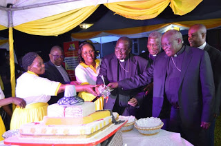 The Bishops assisting the women to cut a cake to  crown the fundraising  dinner
