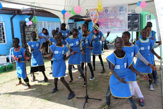Refugee children singing welcome song