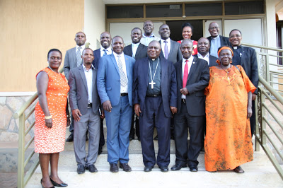 Bishop Ssemogerere and Msgr Kauta pose for a group photo with the new UNCCLA Executive Committee members