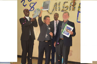 Rt. Rev. Joseph Alessandro (holding microphone) chairman Chairman of KCCB Commission for Refugees, Migrants and Seafarers, Rt. Rev. Virgilio Pante, Vice Chairman of the same Commission and KCCB Secretary General Rev. Fr. Daniel Rono (left) during the celebrations to mark 104 World Day of Migrants and Refugees in Nairobi